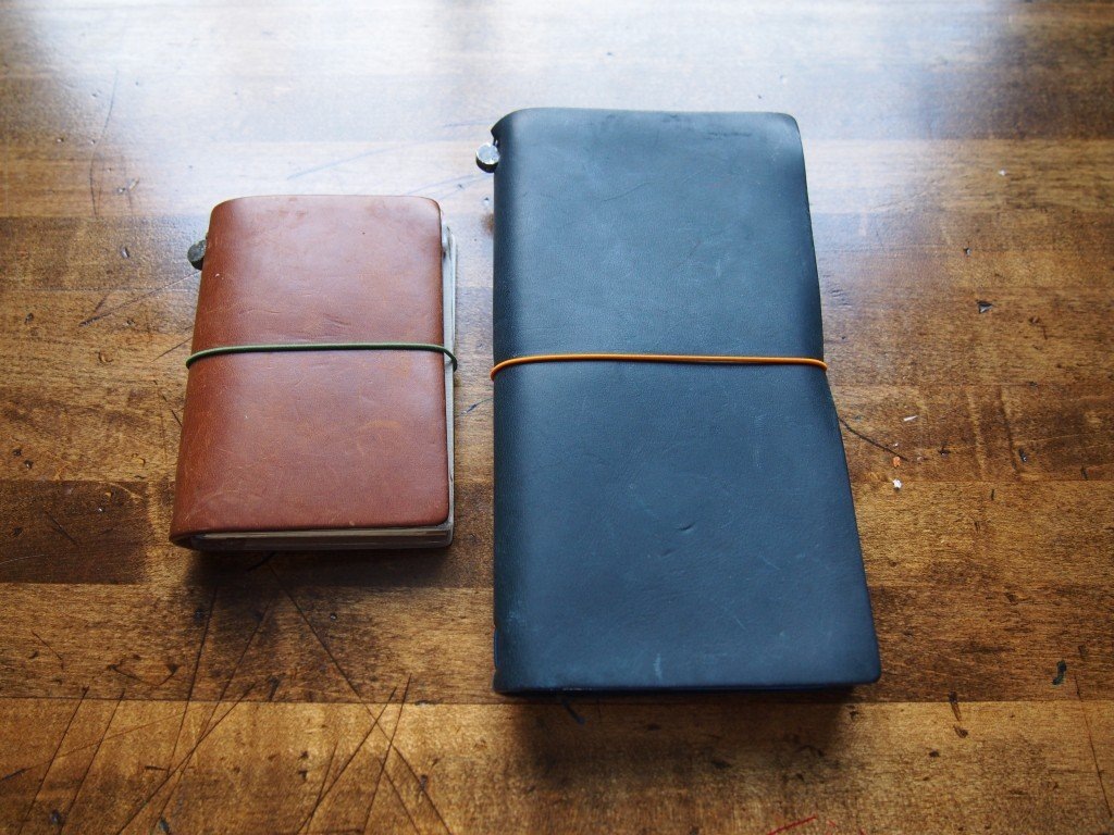 Brown and blue travellers notebooks